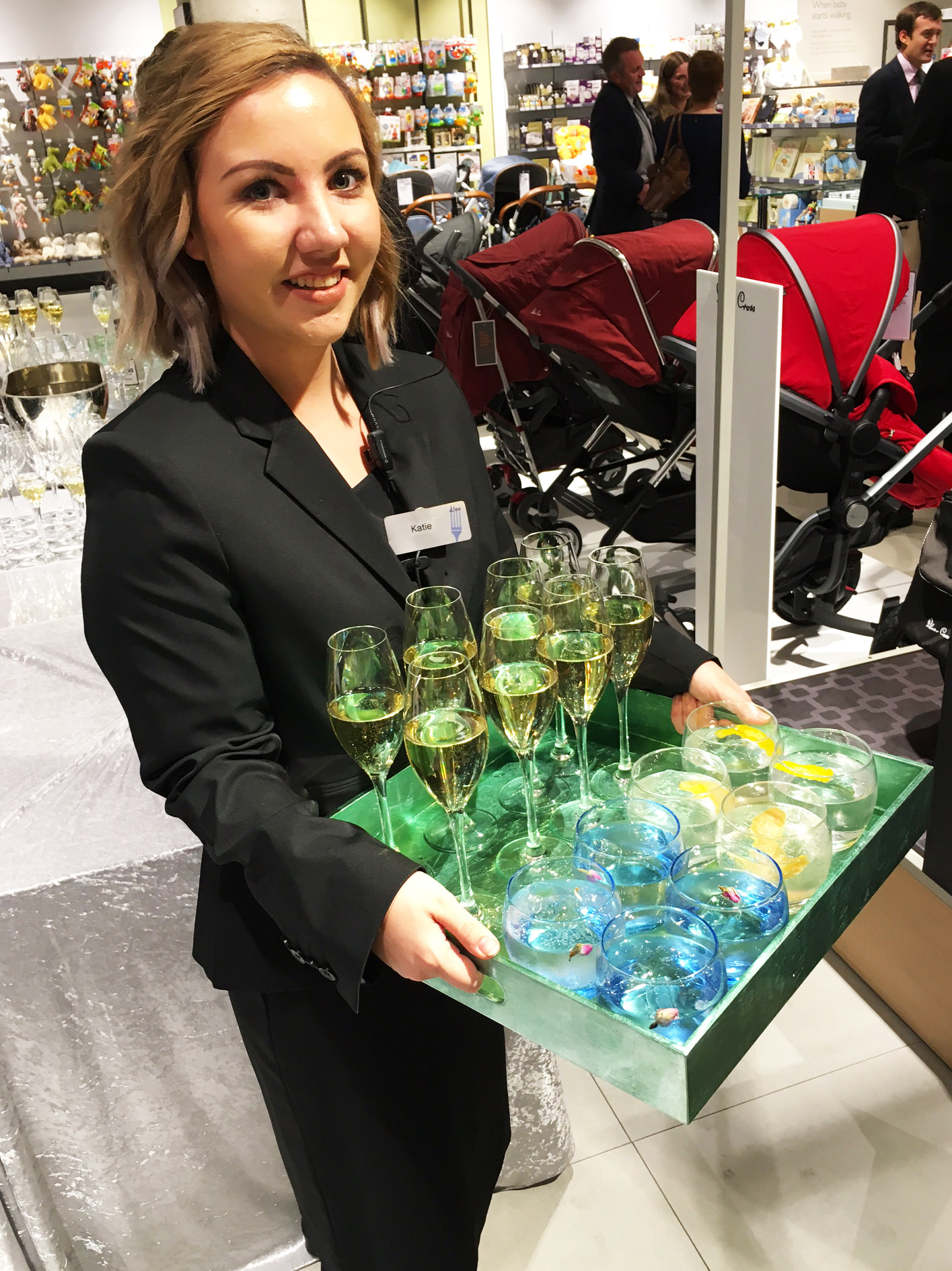 Katie serving drinks in the John Lewis store, Leeds