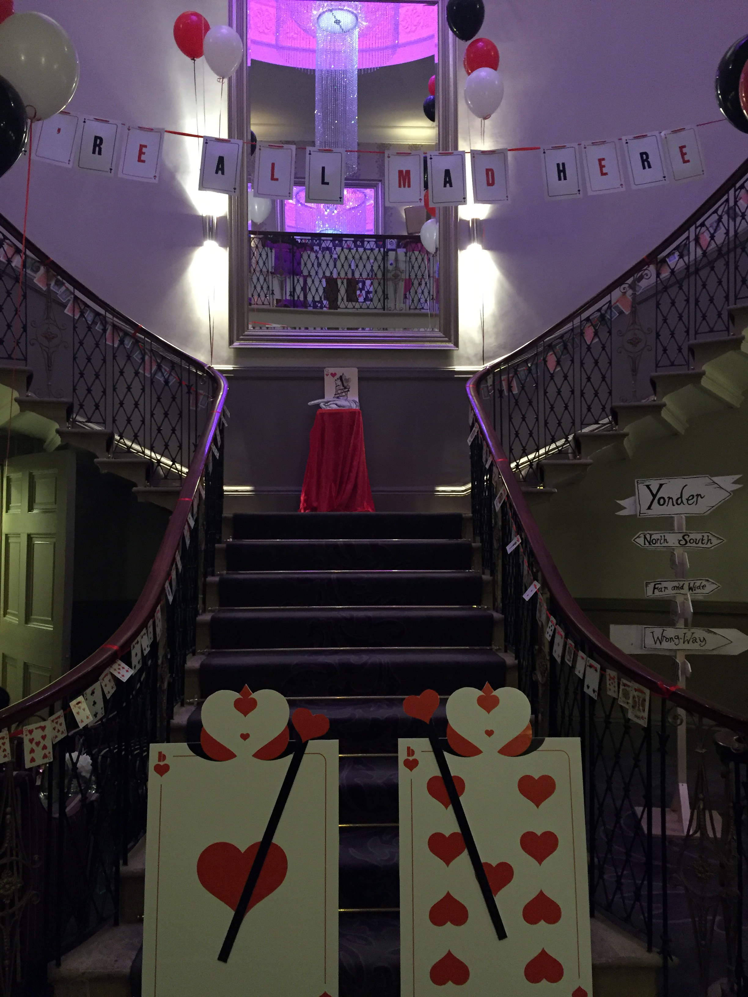 The grand staircase dressed with Alice in Wonderland props